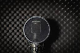 Mike recording studio on a black background. Source: iStock.com, hiindy22
